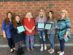From left to right: Mrs. Lauren Clemmer, Krista Thorpe - 2nd place, Mrs. Barbarba Keefer (DAC), Jenna Pindrock - 1st place, Claire White - Honorable Mention, Mrs. Kimberly Bizik, Not pictured is Bailey Kavan - 3rd place